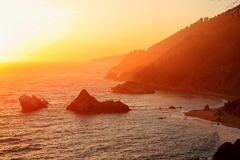 Sunset over Big Sur Coast, Julia Pfeiffer-Burns State Park, California. Vibrant spring sunset reveals the textured succession of the Pacific slopes along the Big stock photos