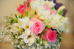Vibrant spring wedding bouquet. Horizontal shoot of a colorful spring flower arrangement with roses and freesias for the future bride in her big day. Creative Stock Image