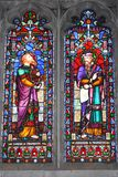Vibrant Stained Glass Church Window. A vibrant stained glass window depicting two religious figures Stock Photography