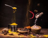 Still life .Spices in movement, colors and flavors. Vibrant still life with a wide range of spices with different colors and flavors on the dark background stock photos