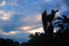 Vibrant and stormy sunset in the tropics with a silhouette of a royalty free stock image