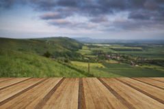 Vibrant sunrise over countryside landscape with wooden planks fl Royalty Free Stock Images