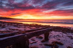 A vibrant sunrise over the erosion groynes in victor harbour south australia on 9th August 2017. Vibrant sunrise over the erosion groynes in victor harbour south royalty free stock photos