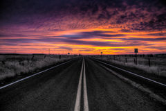Vibrant Sunrise on the Road Stock Images
