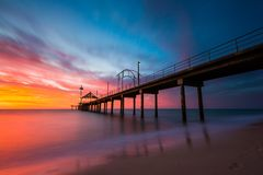 A vibrant sunset at Brighton Jetty in Brighton, Adelaide, South royalty free stock image