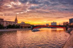 Vibrant sunset cityscape. Moscow river landscape with dramatic skies. Heavy HDR processing stock photography