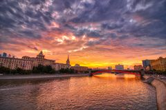 Vibrant sunset cityscape. Moscow river landscape with dramatic skies. Heavy HDR processing royalty free stock image