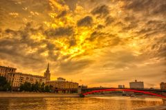 Vibrant sunset cityscape. Moscow river landscape with dramatic skies. Heavy HDR processing royalty free stock photos