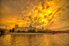 Vibrant sunset cityscape. Moscow river landscape with dramatic skies. Heavy HDR processing royalty free stock photography