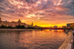 Vibrant sunset cityscape. Moscow river landscape with dramatic skies. Heavy HDR processing royalty free stock images