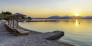Vibrant sunset on Nikiana beach in Lefkada island. Skyline with a vibrant sunset over Nikiana beach in Lefkada island royalty free stock photos