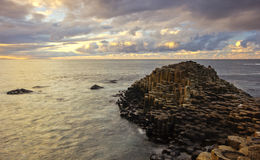 Vibrant sunset over the Giant's Causeway Royalty Free Stock Photos