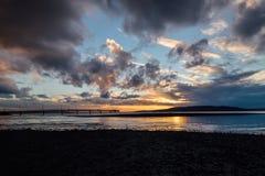 Vibrant Sunset over the Puget Sound. Brilliant Sunset over the Puget Sound from Des Moines Pier in Washington state Royalty Free Stock Photos