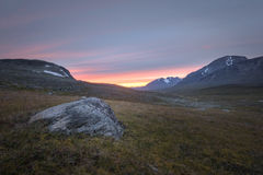 Vibrant sunset over the rocky Sarek plains Sweden Stock Images