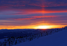 Vibrant Sunset Over Snow Covered Mountain Stock Photo