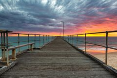 A vibrant sunset at the Port Noarlunga Jetty South Australia on 15th April 2019. Vibrant sunset at the Port Noarlunga Jetty South Australia on 15th April 2019 stock images