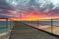 A vibrant sunset at the Port Noarlunga Jetty South Australia on 15th April 2019. Vibrant sunset at the Port Noarlunga Jetty South Australia on 15th April 2019 royalty free stock image