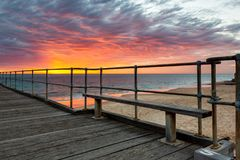 A vibrant sunset at the Port Noarlunga Jetty South Australia on 15th April 2019. Vibrant sunset at the Port Noarlunga Jetty South Australia on 15th April 2019 royalty free stock images
