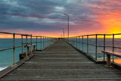 A vibrant sunset at the Port Noarlunga Jetty South Australia on 15th April 2019. Vibrant sunset at the Port Noarlunga Jetty South Australia on 15th April 2019 stock image