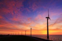 Vibrant sunset turbines Stock Photography