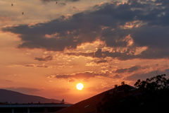 Vibrant Sunset. View From Town With Mountains stock photo
