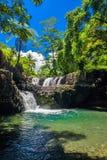 Vibrant Togitogiga falls with swimming hole on Upolu, Samoa. Islands royalty free stock photo