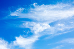 Vibrant vacation summer background with idyllic white fluffy unusual shape clouds Royalty Free Stock Photos