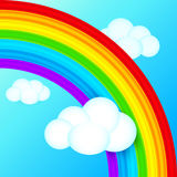 Vibrant vector rainbow in sky with white clouds Royalty Free Stock Photography