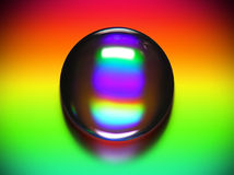 Vibrant water drop. Water drop on a vibrant rainbow background, with clipping path Stock Image