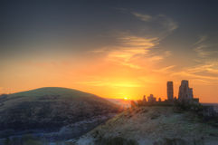 Vibrant Winter landscape sunrise over castle ruins Royalty Free Stock Images