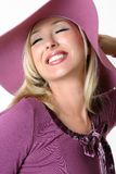 Vibrant woman in a large brimmed hat Stock Photography