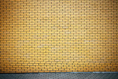 Vibrant yellow brick wall Stock Photos
