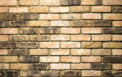 Vibrant yellow brick wall as a background image. With vignette Royalty Free Stock Photos