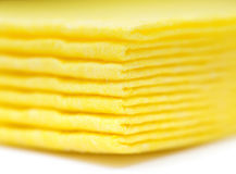 Vibrant yellow cloth kitchen napkins  on white. Royalty Free Stock Photos