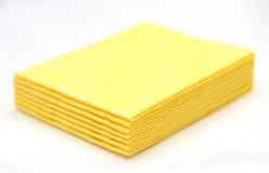 Vibrant yellow cloth kitchen napkins  on white. Royalty Free Stock Photo