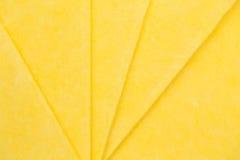 Vibrant yellow cloth kitchen napkins  on white. Stock Photo