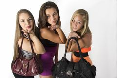 Vibrant young Teenager Girls holding there bags Royalty Free Stock Images