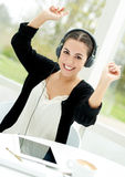 Vibrant young woman enjoying her music Royalty Free Stock Images