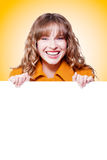 Vibrant young woman holding blank sign Stock Photo