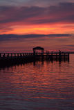 Vibrantly Colored Sunset over the Bay. A vibrantly colored sky reflects out over the bay at sunset stock photography