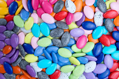 Vibrantly colorful candy pebbles spread evenly. Colorful background. Royalty Free Stock Images