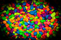 Vibrantly colorful pebbles spread is beautiful background. Stock Photography