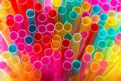 Vibrantly multicolored drinking straws Stock Photo