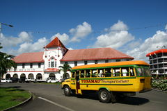 Vibrantly painted bus in Samoa stock photos