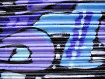 Vibrantly painted graffiti on metal Royalty Free Stock Images