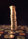 Vibrating column of coins Stock Photo