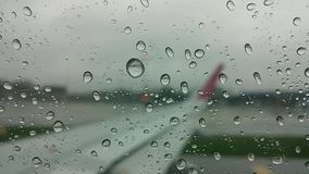 Vibrating drop of water on a plane window stock video footage