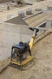 Vibrating machine at construction site Stock Photo