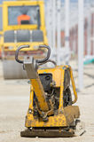 Vibrating plate compactor at construction site Stock Images
