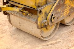 Vibrating roller. Little vibrating roller in construction site Royalty Free Stock Photos